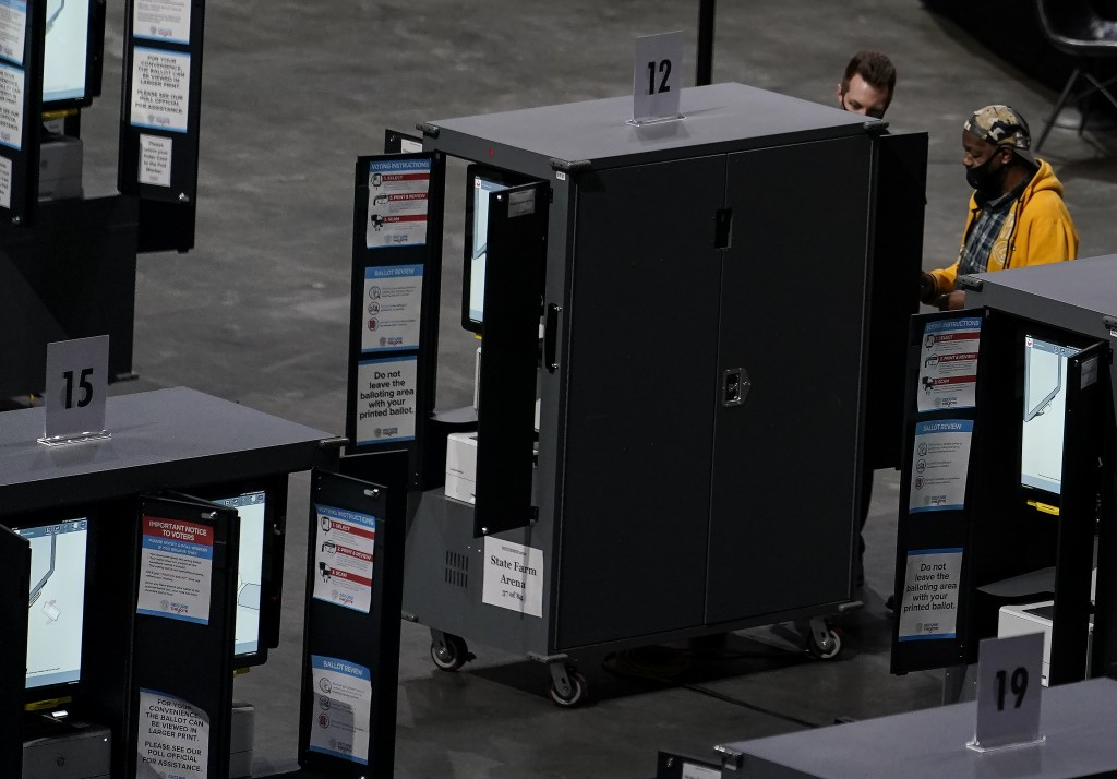 Gary Ragland, 64, of East Point, Ga., votes at State Farm Arena on Wednesday, Oct. 28, 2020, in Atlanta. In the best of times, it's a massive logistic...