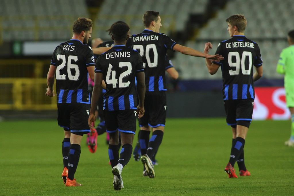 Brugge's Hans Vanaken, center, celebrates with teammates after scoring his side's first goal during the Champions League Group F soccer match between ...