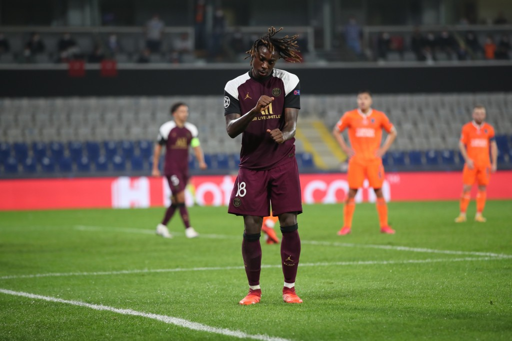 PSG's Moise Kean dances as he celebrates his goal during the Champions League group H soccer match between Basaksehir and Paris Saint Germain in Istan...