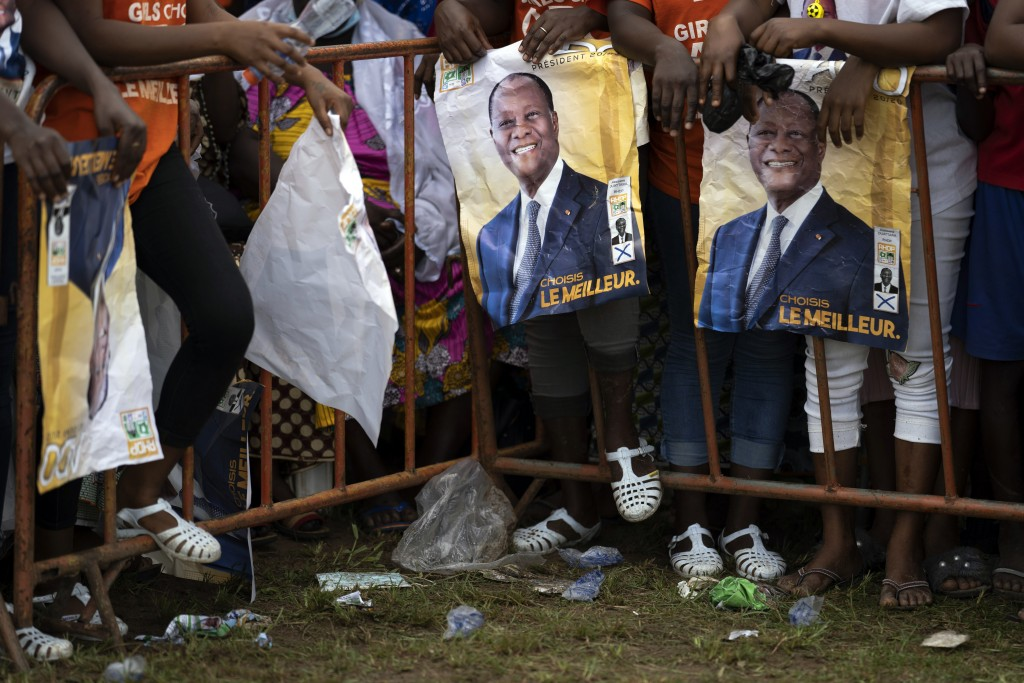 Supporters wait for the arrival of the Ivory Coast President Alassane Ouattara at a rally in Anyama, in the outskirts of Abidjan, Ivory Coast, Wednesd...