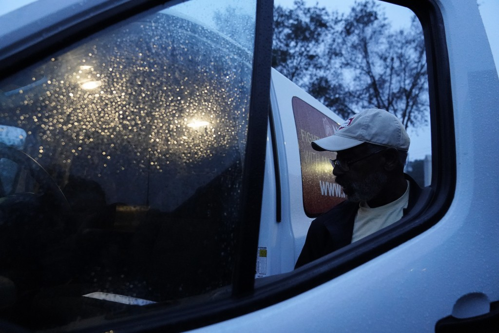"""Neighborhood Assistance Corporations of America, employee, Malcom Williams, 65, of Loganville, Ga., gets into a NACA van, for a """"Roll to the Polls"""" da..."""