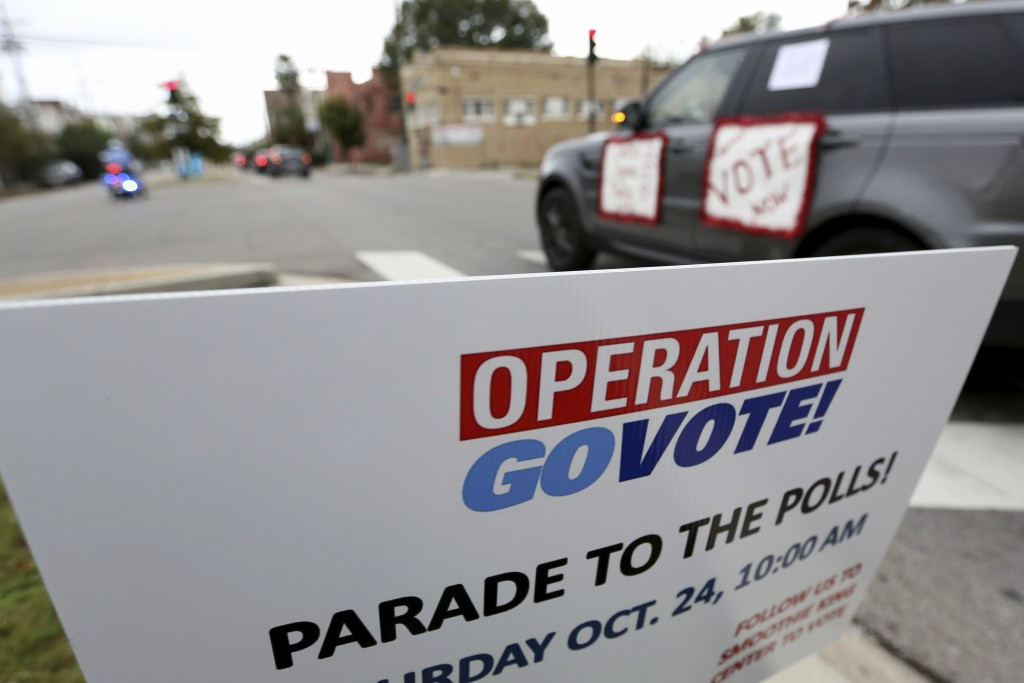 """People participate in a """"Parade to the Polls"""" event, organized by Operation Go Vote!, a collaborative of African American civic and social organizatio..."""