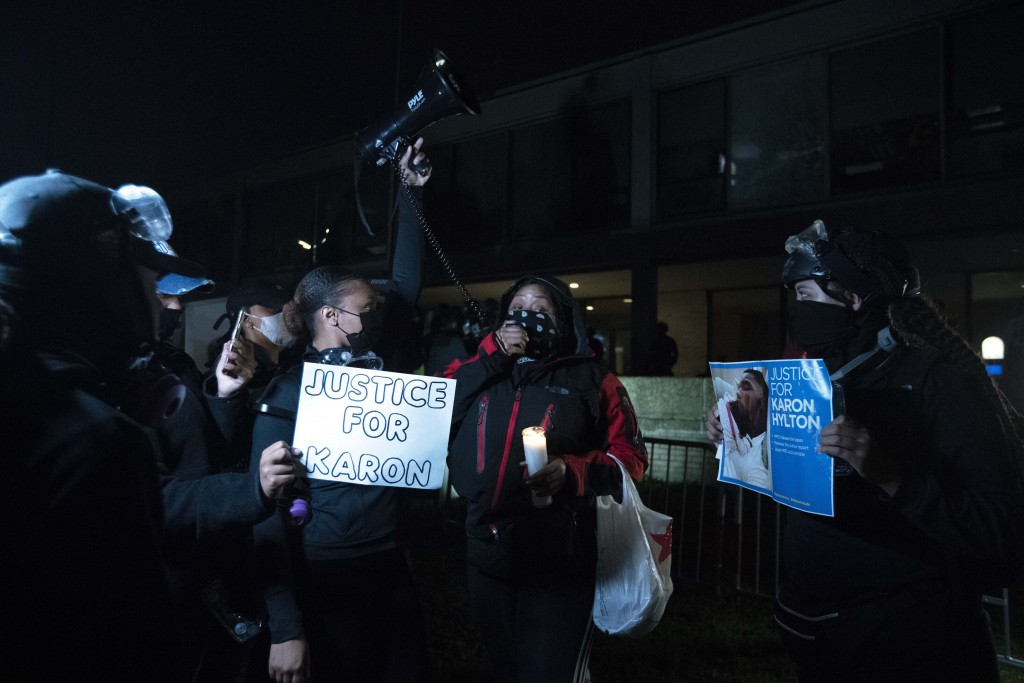 Demonstrators protest at the fourth district Washington police station in Washington, Wednesday, Oct. 28, 2020. Demonstrators gathered at the police s...