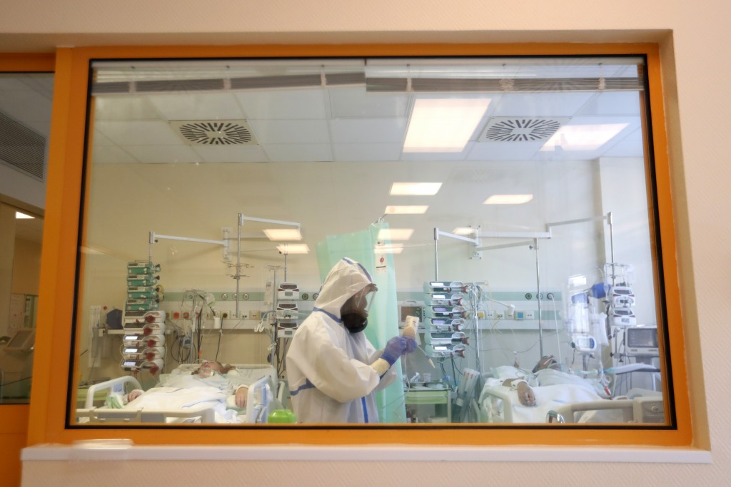 Health care worker attends to COVID-19 patients at an intensive care unit (ICU) at a hospital in Kyjov, Czech Republic, Thursday, Oct. 22, 2020. With ...