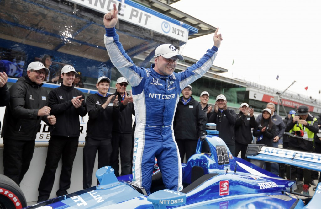FILE - In this May 10, 2019, file photo, Felix Rosenqvist, of Sweden, celebrates after winning the pole during qualifications for the Indy GP IndyCar ...