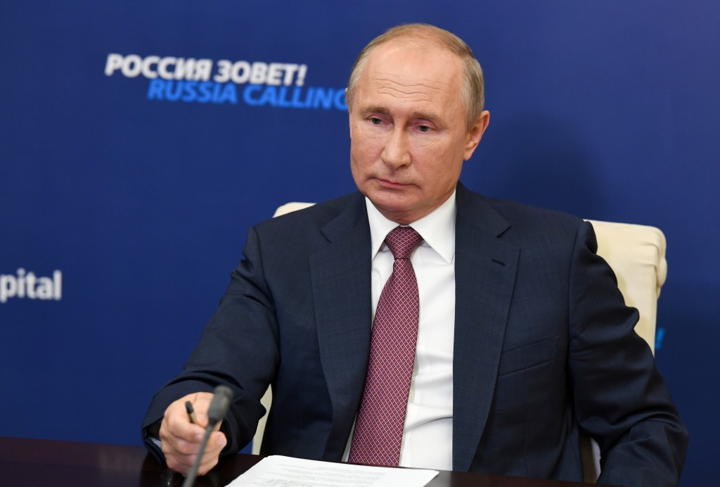 """FILE - Russian President Vladimir Putin attends an annual VTB Capital """"Russia Calling!"""" Investment Forum via video conference at the Novo-Ogaryovo res..."""