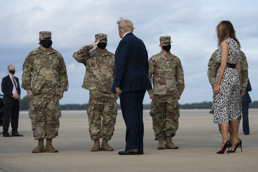 President Donald Trump and first lady Melania Trump arrive at Pope Army Field for an event with troops at Fort Bragg, Thursday, Oct. 29, 2020, in Pope...