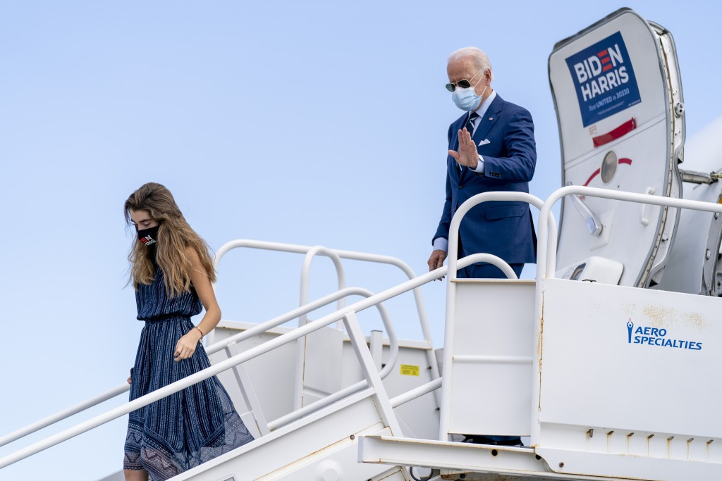 Democratic presidential candidate former Vice President Joe Biden, accompanied by his granddaughter Natalie Biden, arrives at Ft. Lauderdale-Hollywood...