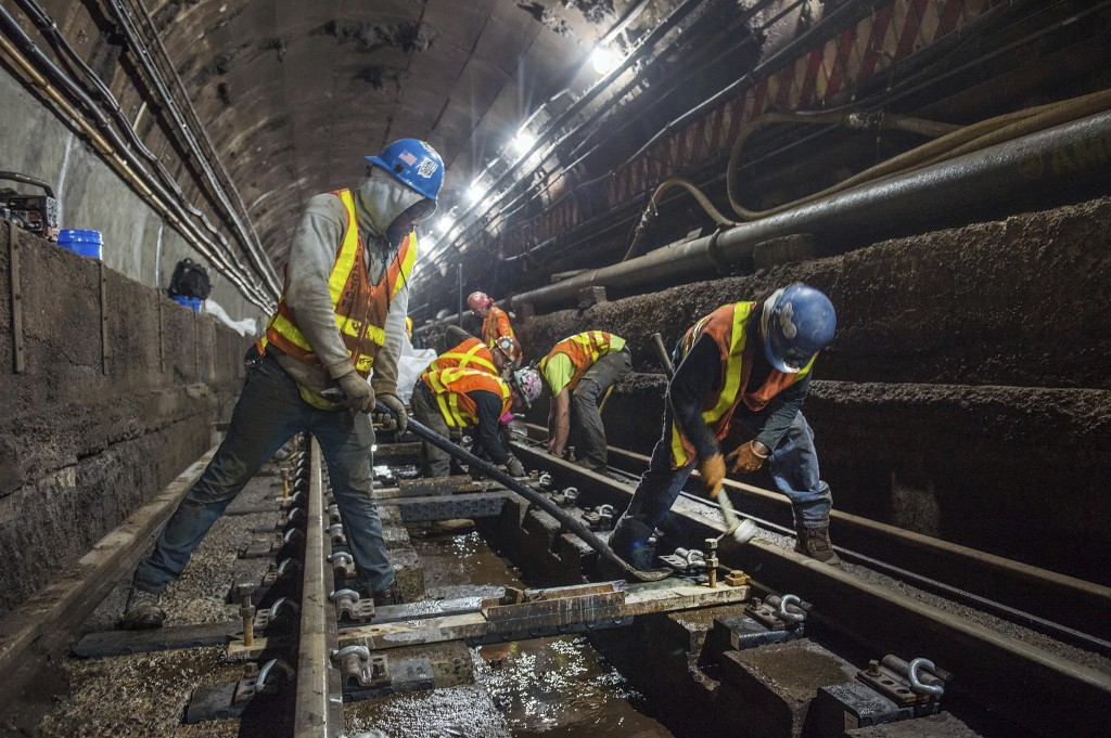 This June 15, 2019 photo provided by the Metropolitan Transportation Authority shows workers during the L Project subway tunnel rehabilitation, in New...