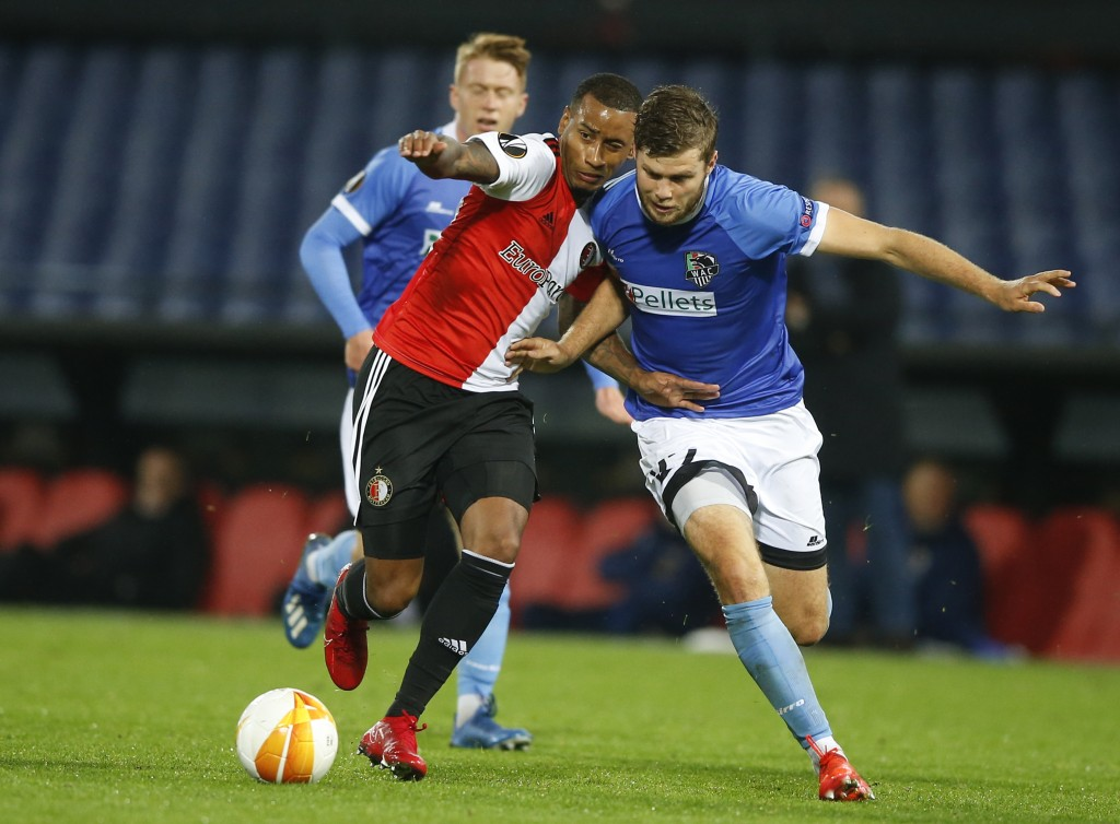 Feyenoord's Luciano Narsingh, left, and Wolfsbergs' Dominik Baumgartner, right, vie for the ball during the Group K Europa League soccer match between...