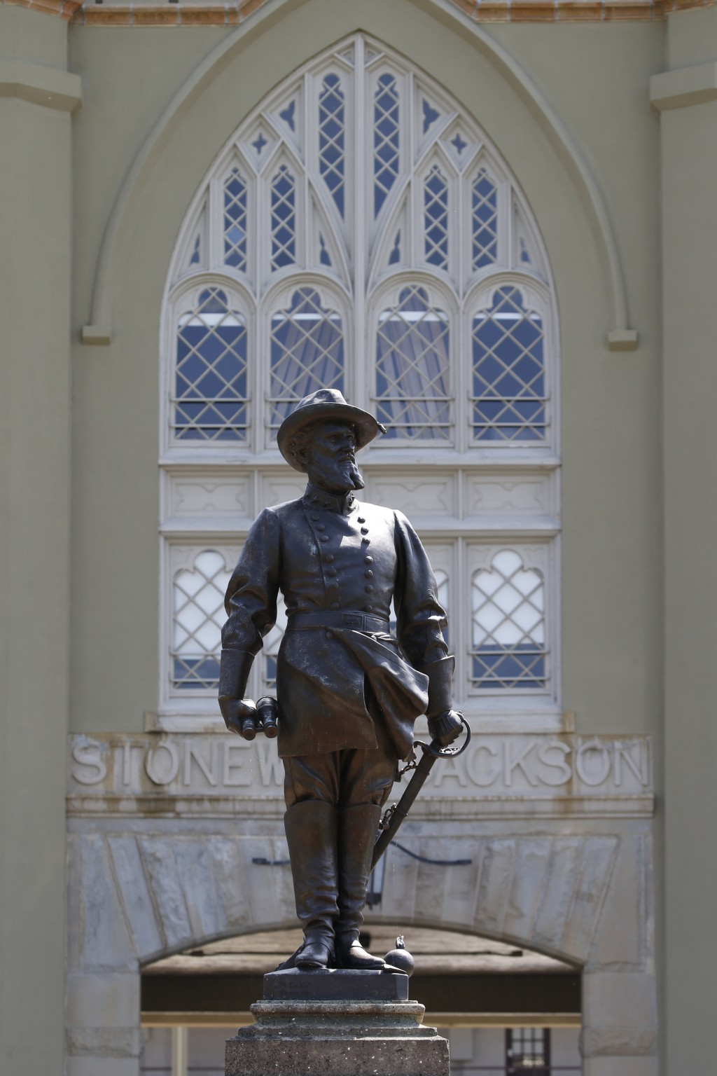 FILE - In this July 15, 2020 file photo the statue of Confederate General Stonewall Jackson stands at the entrance to the barracks at the Virginia Mil...