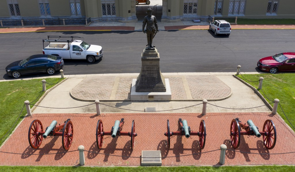 FILE - In this July 15, 2020 file photo the statue of Confederate General Stonewall Jackson stands behind canons at the entrance to the barracks at Vi...