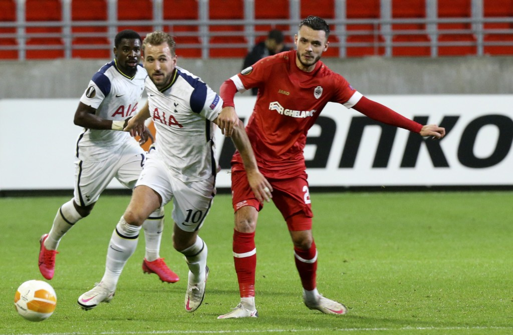 Tottenham's Harry Kane, center, vies for the ball against Royal Antwerp's Jeremy Gelin during the Europa League Group J soccer match between Antwerp a...