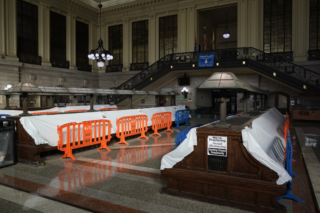 Tarps and fences block the seating area in the Hoboken Terminal waiting room in Hoboken, N.J., Tuesday, Oct. 27, 2020. Once a gleaming symbol of early...