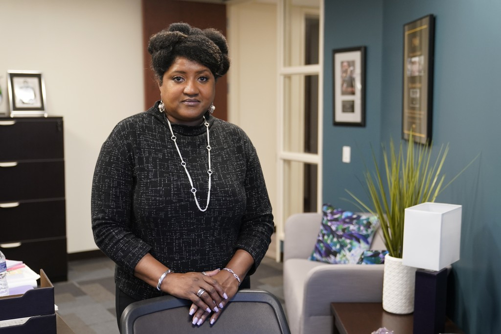 Lisa Rice, President and CEO of the National Fair Housing Alliance, poses for a photo in her office, Wednesday, Oct. 28, 2020, in Washington. Several ...