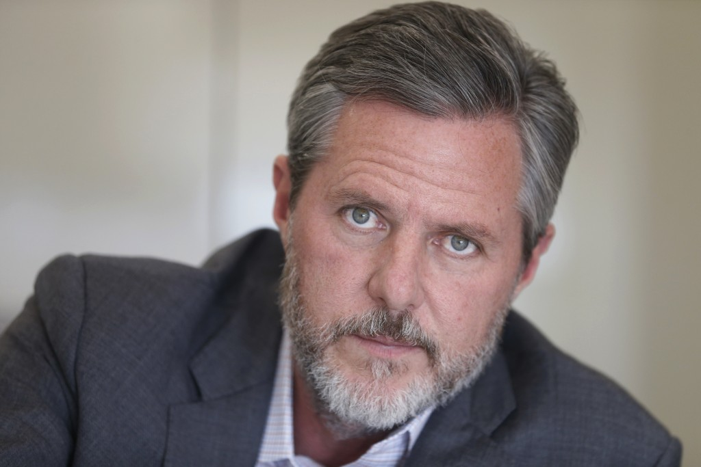 FILE - In this Nov. 16, 2016 file photo, Liberty University president Jerry Falwell Jr., poses during an interview in his offices at the school in Lyn...