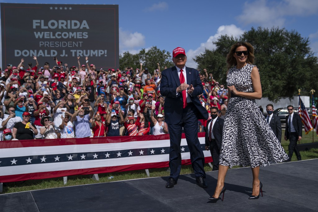 President Donald Trump and first lady Melania Trump arrive for a campaign rally outside Raymond James Stadium, Thursday, Oct. 29, 2020, in Tampa. (AP ...