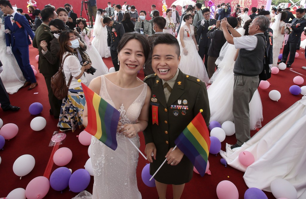 Lesbian couple Yi Wang, right, and Yumi Meng pose during a military mass weddings ceremony in Taoyuan city, northern Taiwan, Friday, Oct. 30, 2020. Tw...