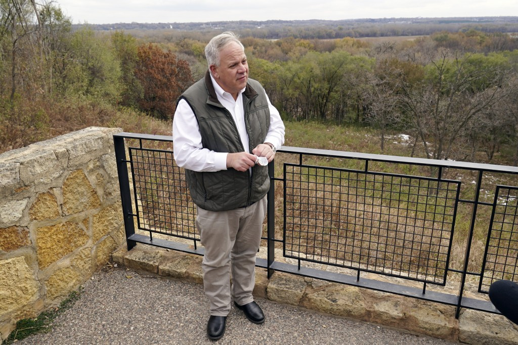 """Interior Secretary David Bernhardt takes reporters' questions overlooking the Minnesota River area after he announced the gray wolf's recovery """"a mile..."""