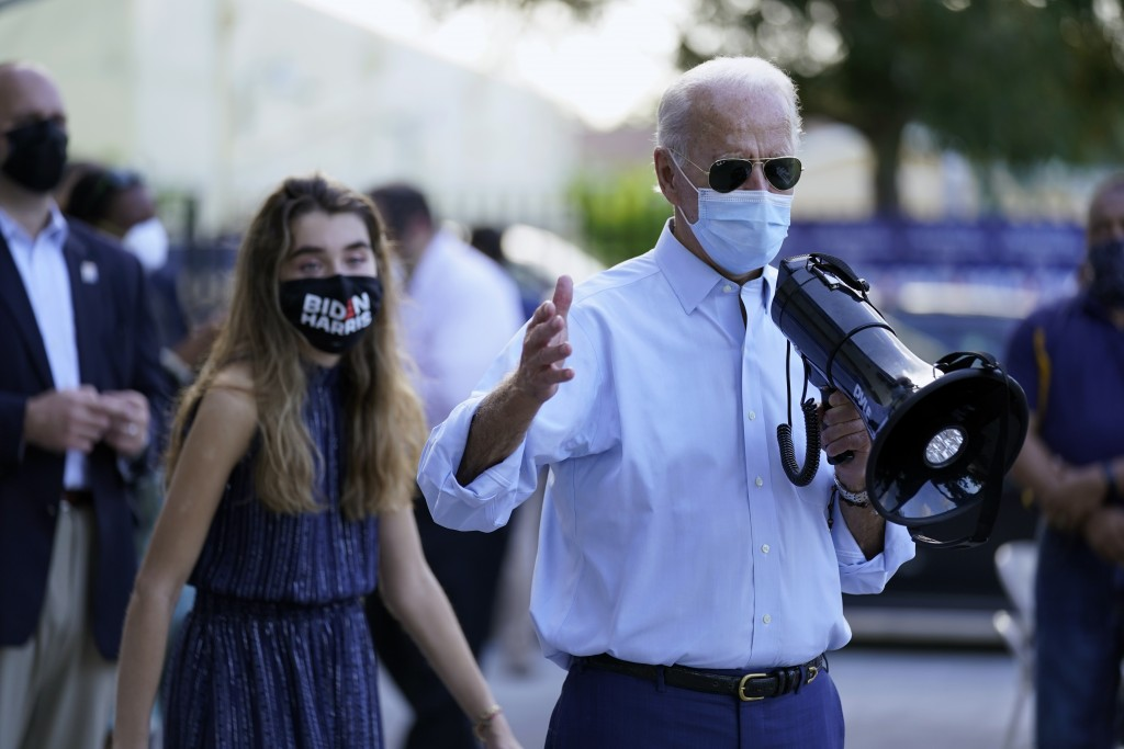 Democratic presidential candidate former Vice President Joe Biden, accompanied by his granddaughter Natalie Biden, speaks to people outside a campaign...