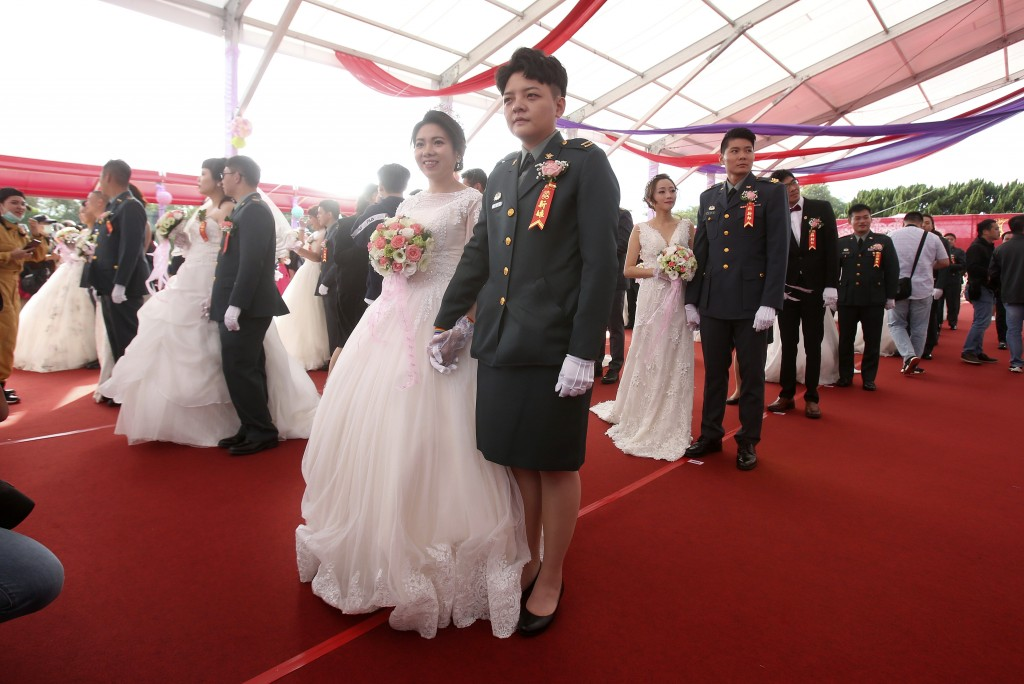 Lesbian couple Chen Ying-hsuan, right, and Li Li-chen attend a military mass weddings ceremony in Taoyuan city, northern Taiwan, Friday, Oct. 30, 2020...