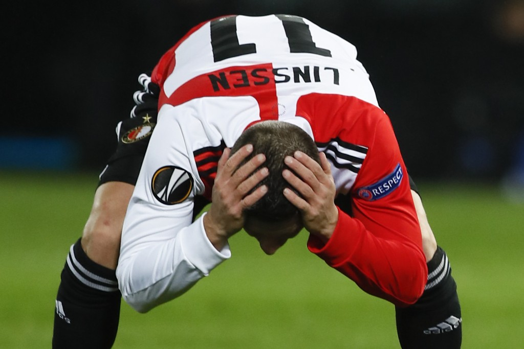 Feyenoord's Bryan Linssen holds his head after missing a chance to score during the Group K Europa League soccer match between Feyenoord and Wolfsberg...