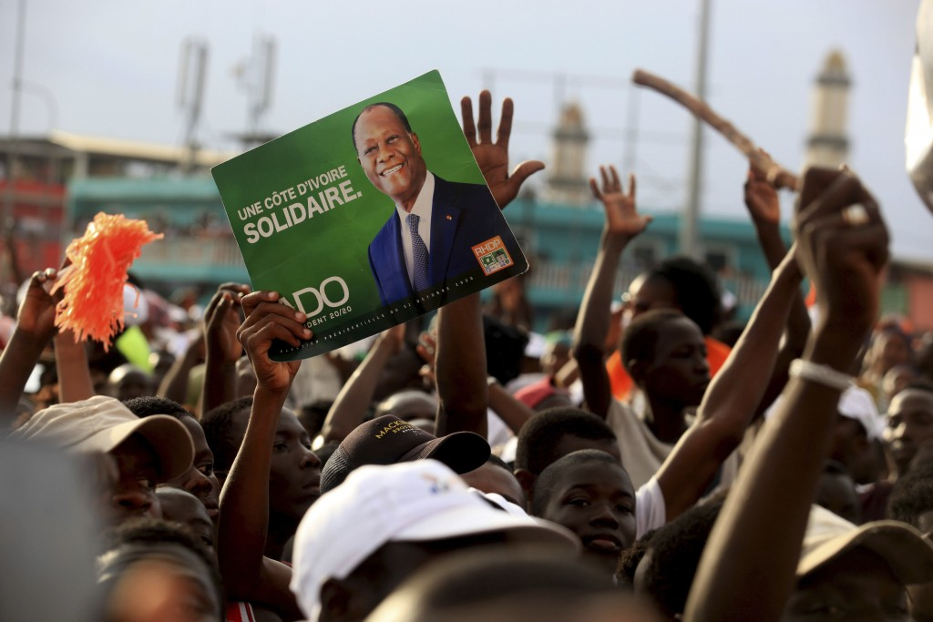 Supporters of President Alassane Ouattara cheers during his last rally in Abidjan, Ivory Coast, Thursday Oct. 29, 2020. Ouattara, who first came to po...