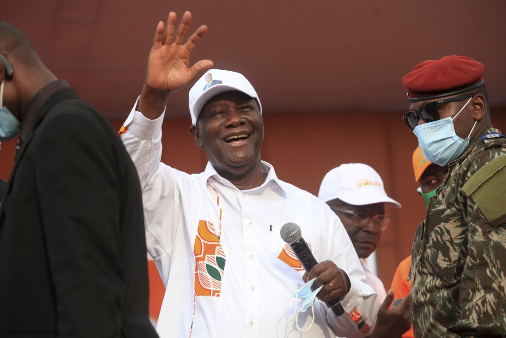 Ivory Coast President Alassane Ouattara cheers during his last rally in Abidjan, Ivory Coast, Thursday Oct. 29, 2020. Ouattara, who first came to powe...