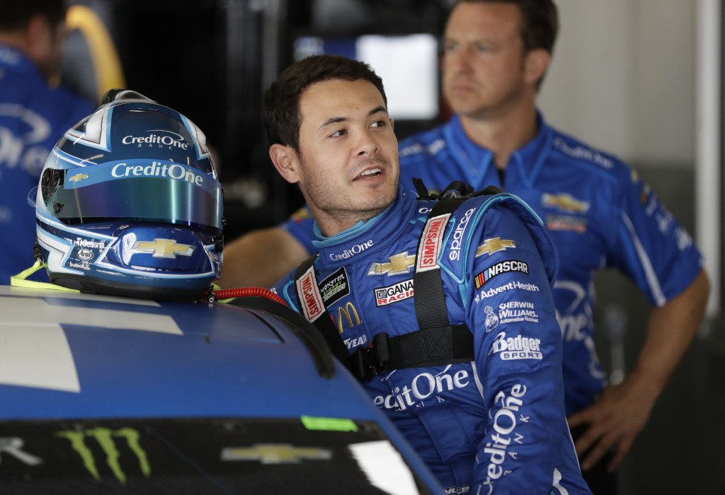 FILE - In this Feb. 15, 2019, file photo, Kyle Larson gets into his car during Daytona 500 auto race practice at Daytona International Speedway in Day...