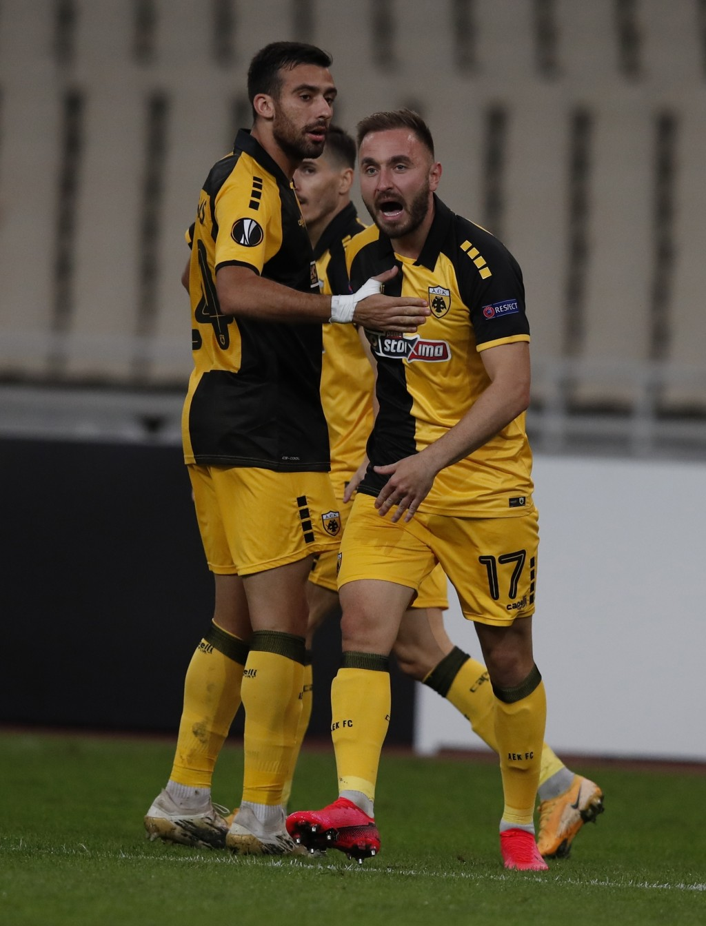 AEK's Muamer Tankovic, right, celebrates his side's first goal during the Europa League group G soccer match between AEK Athens and Leicester at the O...
