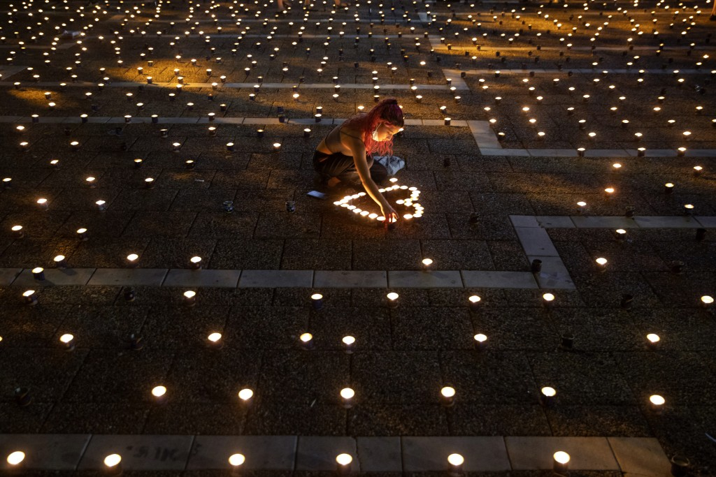 A woman lights memorial candles on the 25th anniversary of the assassination of Israeli Prime Minister Yitzhak Rabin, at Rabin Square, Tel Aviv, Israe...