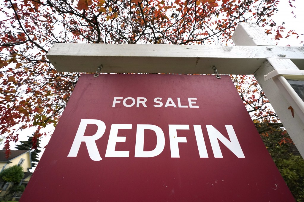 "A Redfin ""for sale"" sign stands in front of a house Wednesday, Oct. 28, 2020, in Seattle. Several fair housing organizations accused Redfin of systema..."