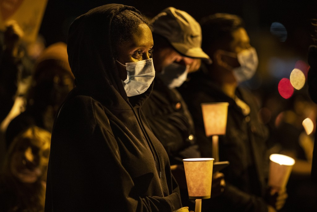 People gather  for Kevin Peterson Jr., who was killed in Thursday's shooting with police involved, at a candlelight vigil in Vancouver, Wash.,  Friday...
