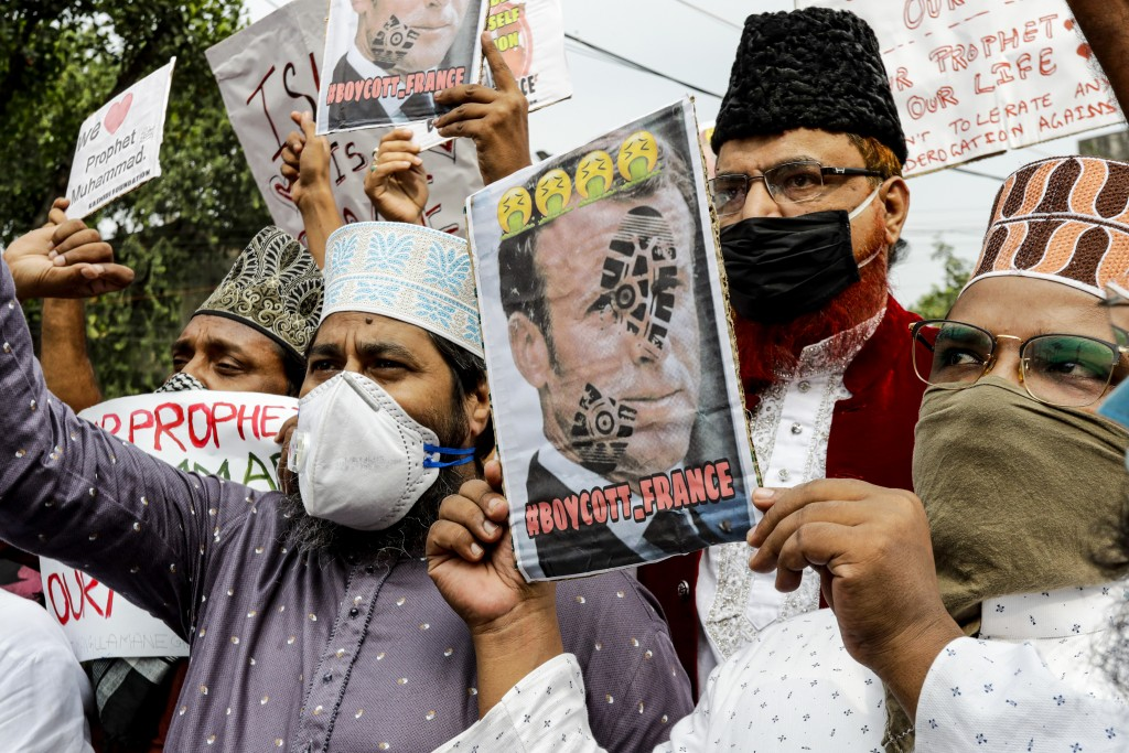 Muslim activists from various organizations hold placards and participate in a protest against France, near the French Consulate, in Kolkata, India, S...