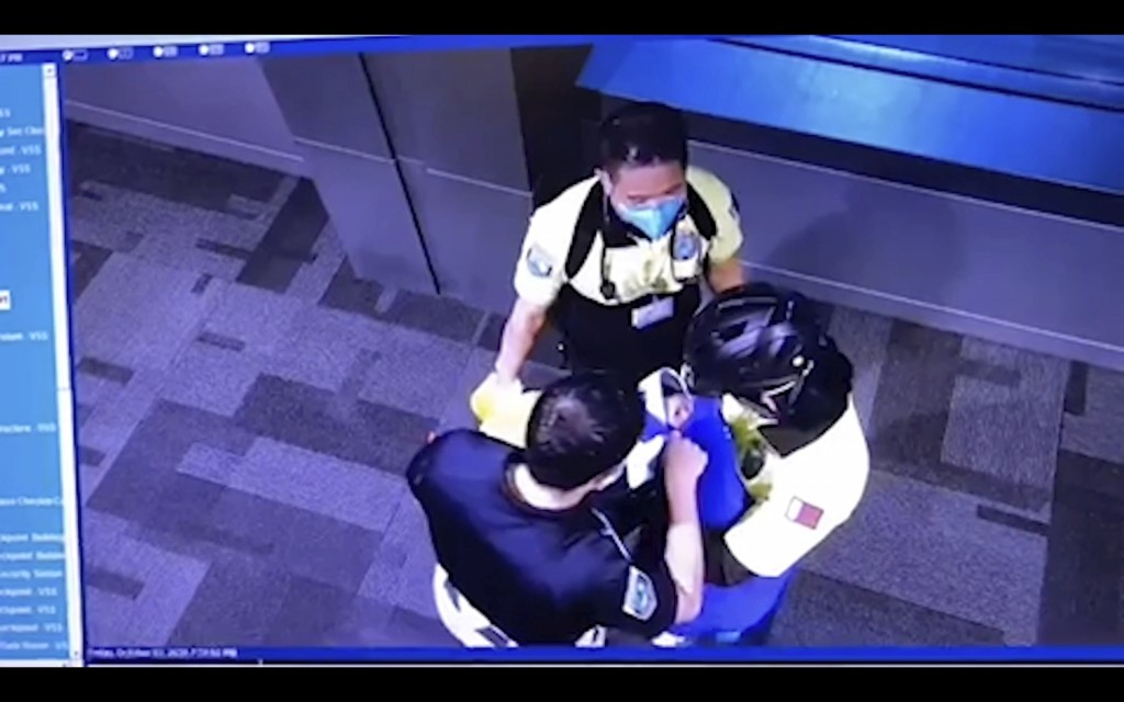 This image made from Oct. 2, 2020 surveillance camera footage obtained by the website Doha News shows officials care for an abandoned baby at Hamad In...