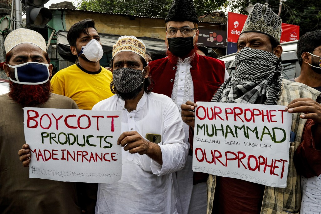 Muslim activists from various organizations participate in a  protest against France, near the French Consulate, in Kolkata, India, Saturday, Oct. 31,...