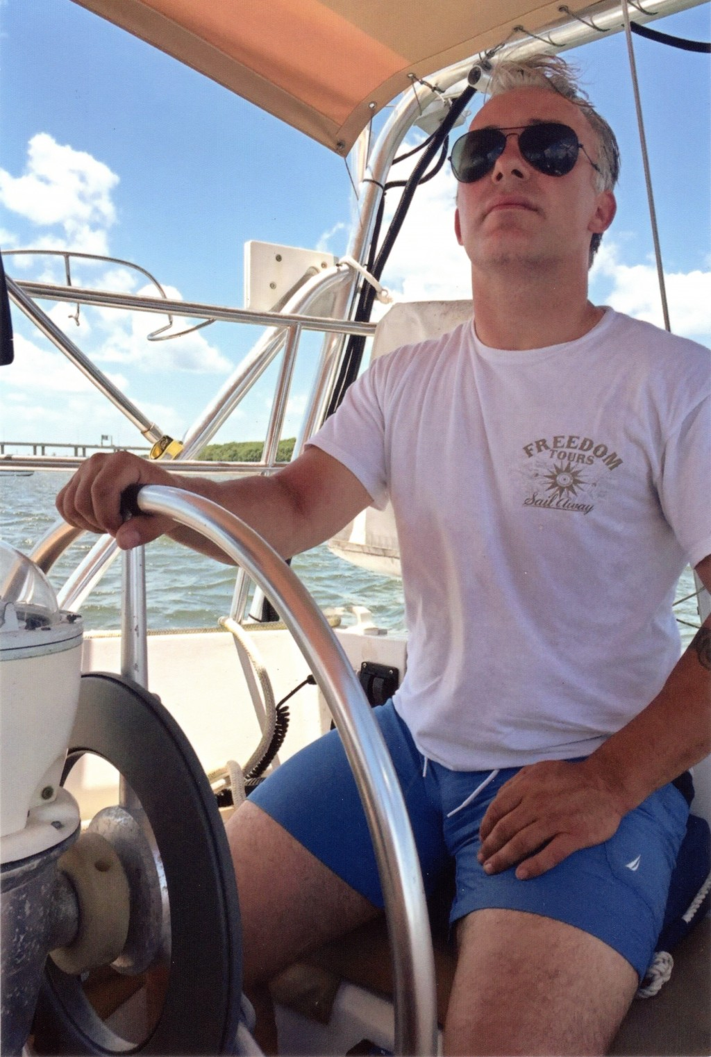 In this undated photo courtesy of the Heath family, Matthew Heath navigates a boat near the Florida Keys. Heath's family says he kept a boat in Key We...