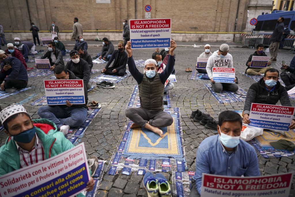 Members of an Italian Muslim association stage a sit-in and prayer to condemn what they see as persecutory acts against the Islamic community in Franc...