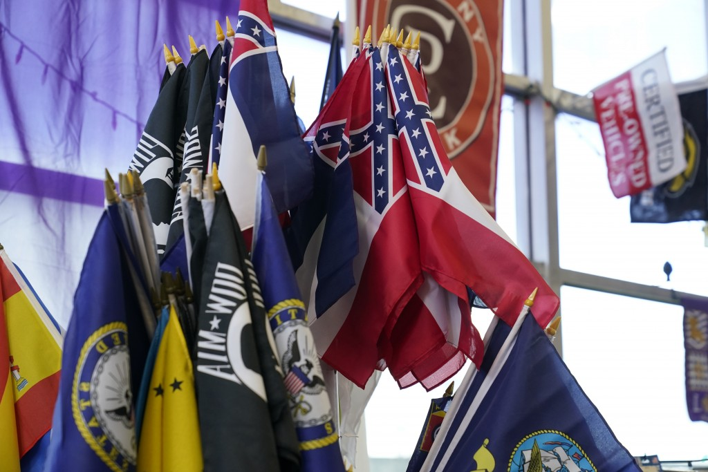 A display stand has a strand of the recently retired Mississippi state flag, mixed with military flags, state flags and special interest flags Tuesday...
