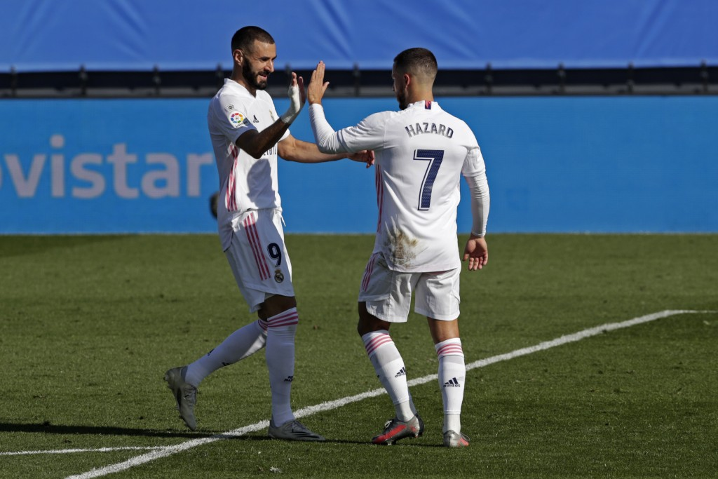 Real Madrid's Eden Hazard, right, celebrates with teammate Karim Benzema after scoring the opening goal during the Spanish La Liga soccer match betwee...