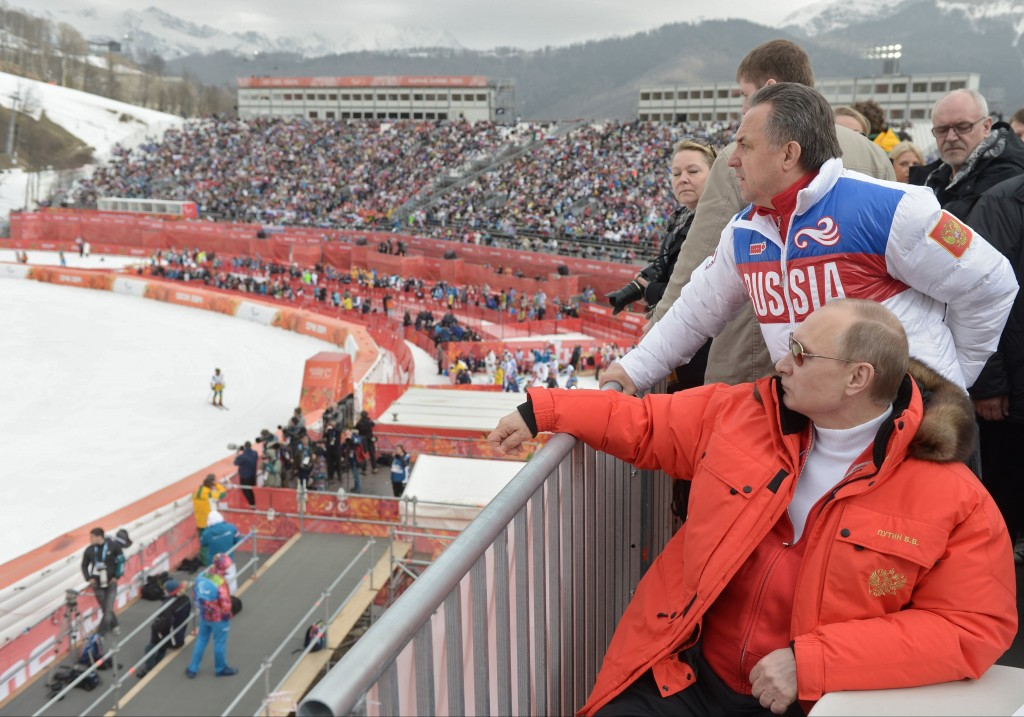 FILE - In this file photo taken Saturday, March 8, 2014, Russian President Vladimir Putin, foreground, and Russia's sports minister Vitaly Mutko, stan...