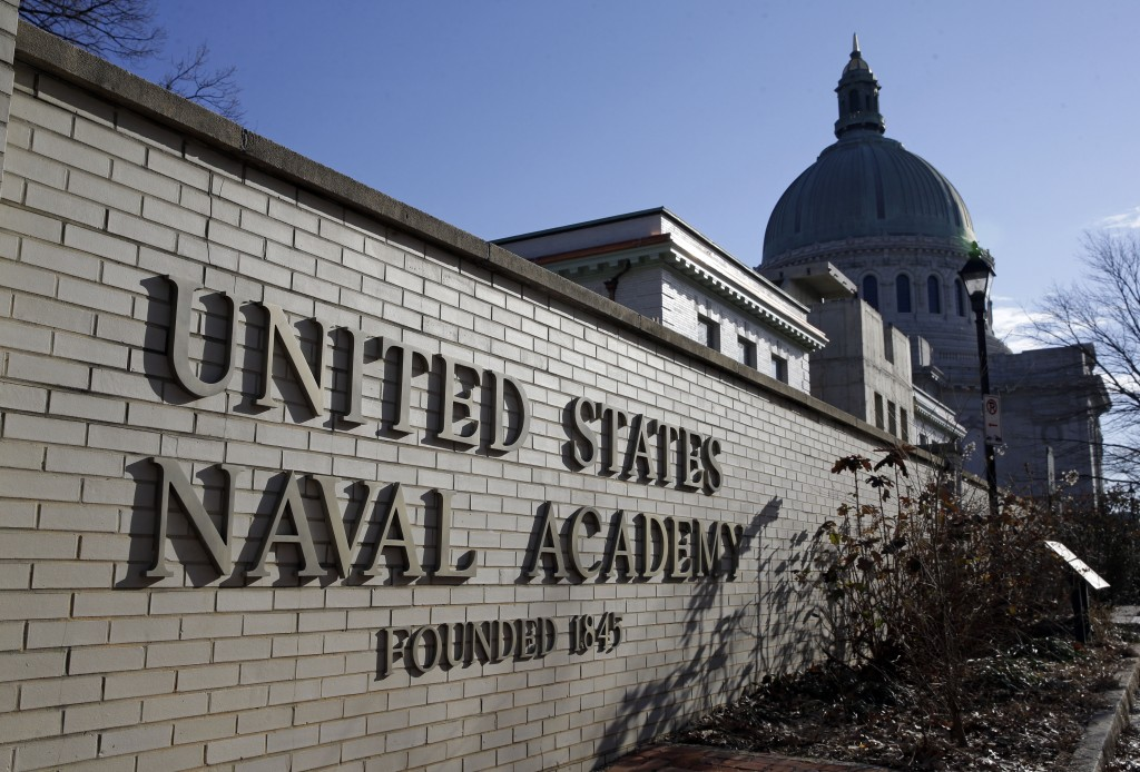 FILE - This Jan. 9, 2014 file photo shows a sign outside of an entrance to the U.S. Naval Academy campus in Annapolis, Md. A U.S. Naval Academy midshi...