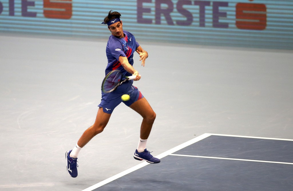 Italy's Lorenzo Sonego returns returns the ball to Andrey Rublev of Russia during their final match at the Erste Bank Open tennis tournament in Vienna...