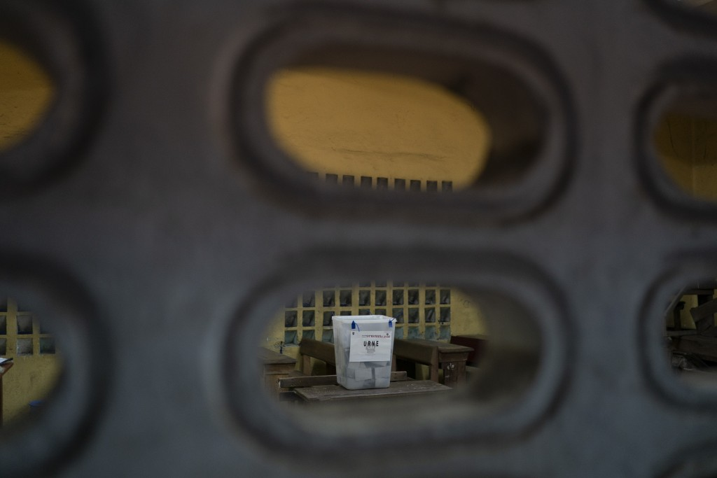 A ballot box is seen at a polling station before being open during presidential elections in Abidjan, Ivory Coast, Saturday, Oct. 31, 2020. Some tens ...