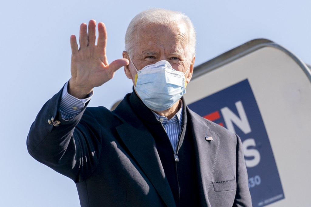 Democratic presidential candidate former Vice President Joe Biden boards his campaign plane at New Castle Airport in New Castle, Del., Saturday, Oct. ...
