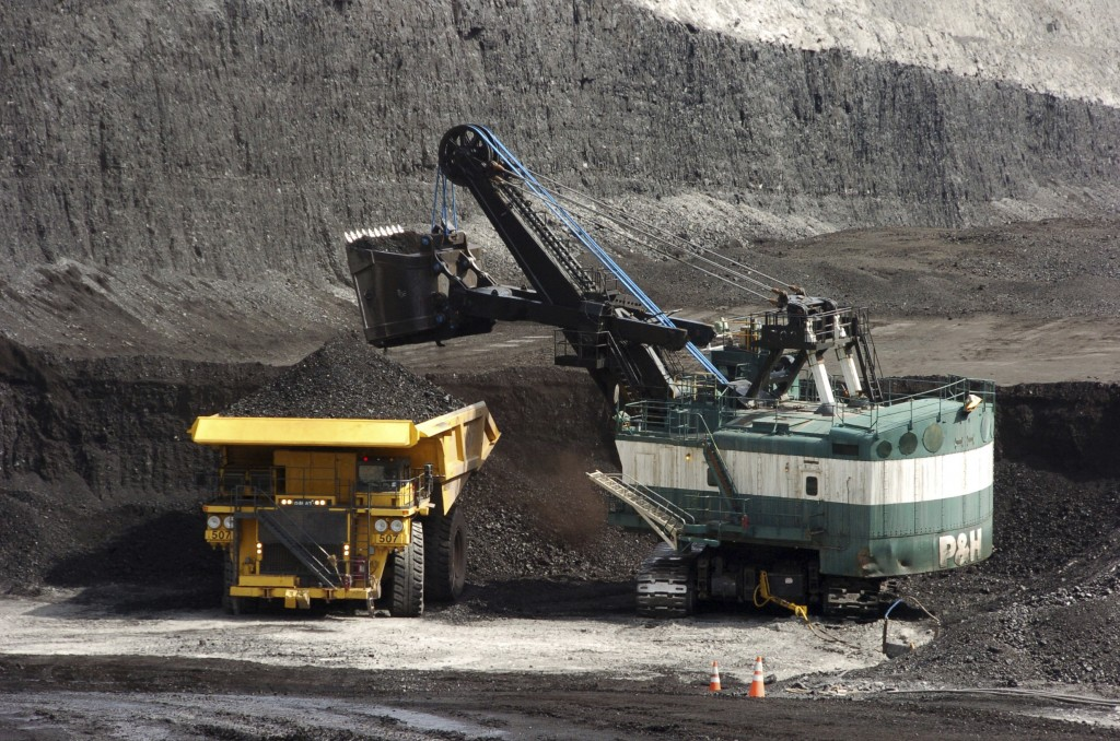 FILE - In this April 4, 2013, file photo, a mechanized shovel loads a haul truck with coal at the Spring Creek coal mine near Decker, Mont. The United...