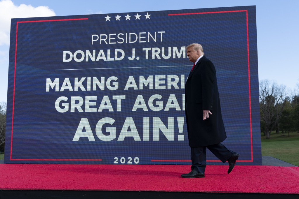 President Donald Trump walks to the podium to speak at a campaign rally at Keith House, Washington's Headquarters, Saturday, Oct. 31, 2020, in Newtown...
