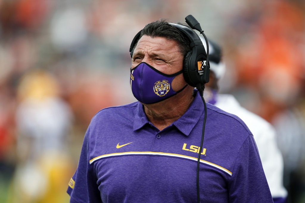 LSU head coach Ed Orgeron walks the sideline during the first quarter of an NCAA college football game against Auburn on Saturday, Oct. 31, 2020, in A...