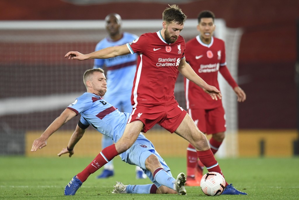 West Ham's Tomas Soucek, left, vies for the ball with Liverpool's Nathaniel Phillips during the English Premier League soccer match between Liverpool ...