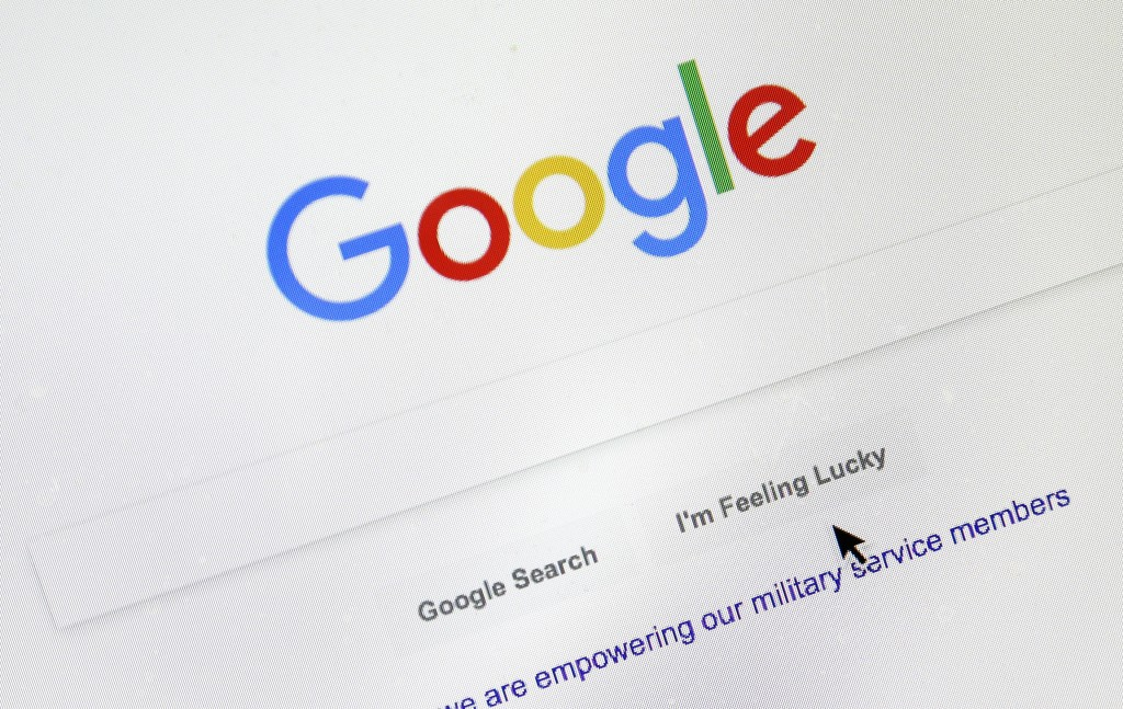 FILE - In this Tuesday, Aug. 28, 2018, file photo, a cursor moves over Google's search engine page, in Portland, Ore. Monopoly or not, small business ...